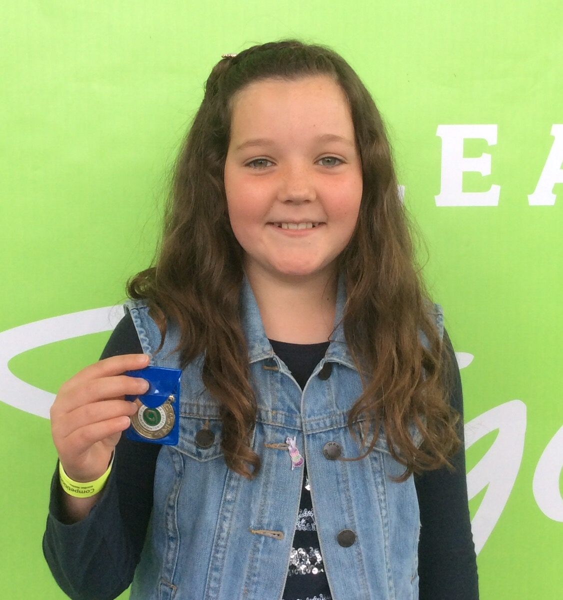 All Ireland Medal winner Cathleen Garland proudly shows off her winning smile along with her silver medal in the ladies Under 12 singing competition in Sligo.