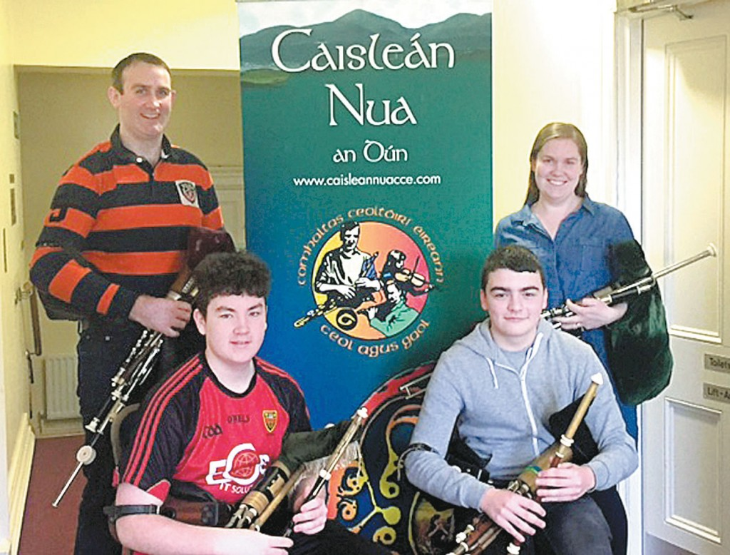 Newcastle CCE pipers Ruaírí Howell (seated left) and Matthew McAstocker (right) pictured with Newcastle CCE master tutor Padraig McGovern and branch tutor Vivienne Mulcahy (standing).