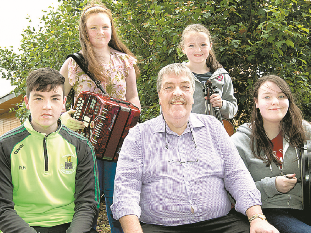 Terry Cowan is pictured with grandchildren Ruairi, Tara and Enya Howell, along with Erin Maginn. Together the family brought home 28 medals. (Absent from photograph is Niamh Howell).
